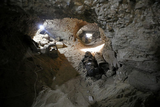 mummy inside the newly discovered burial site in Minya, Egypt