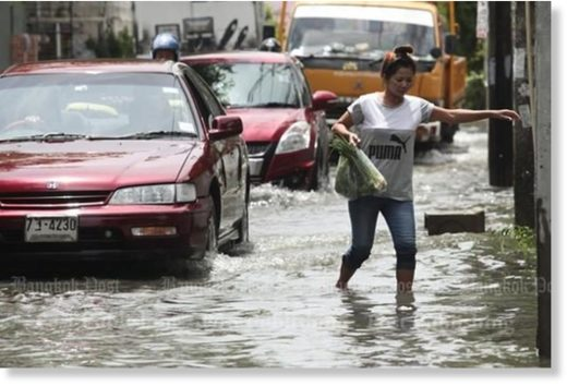 Flooded roads and heavy traffic is a major inconvenience for pedestrians as well as motorists.
