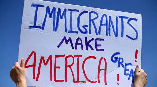protester sign on immigration