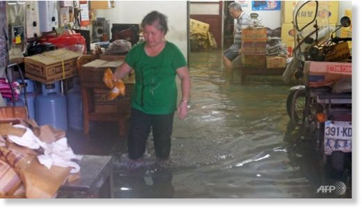 Local residents stay in their flooded home during heavy rain in Jinshan, New Taipei