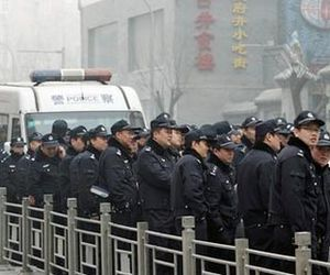 Police officers stand guard-China