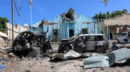 destruction and wreckages of cars after an attack on a government building in Mogadishu