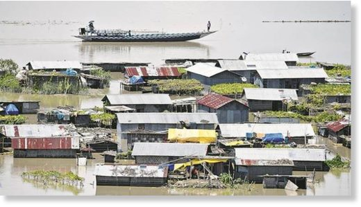 Partially submerged houses in Morigaon district of Assam, Friday