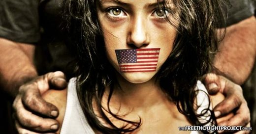 girl with US flag over mouth