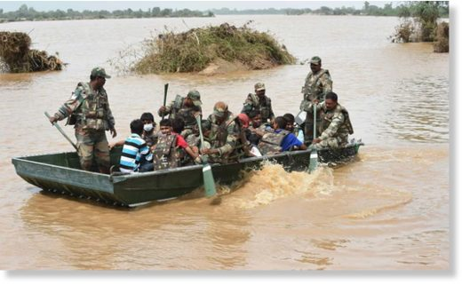 Soldiers bring to safety stranded flood victims in Khariya village, Gujarat. Photograph: Sam Panthaky