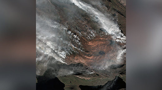 satellite images of a massive wildfire in Greenland