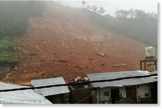 At least 300 have been killed after a mudslide (pictured) sparked by heavy rain crashed through part of Sierra Leone's capital