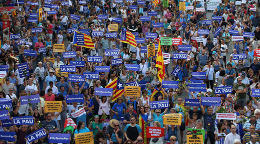 People hold placards and flag as they take part in a march of unity after last week attacks, in Barcelona