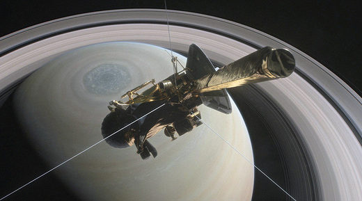 Cassini is pictured above Saturn