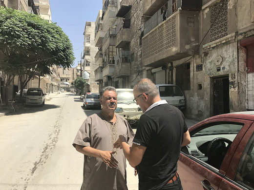 Meeting Abu Omar outside his home in East Aleppo with journalist Khaled Iskef