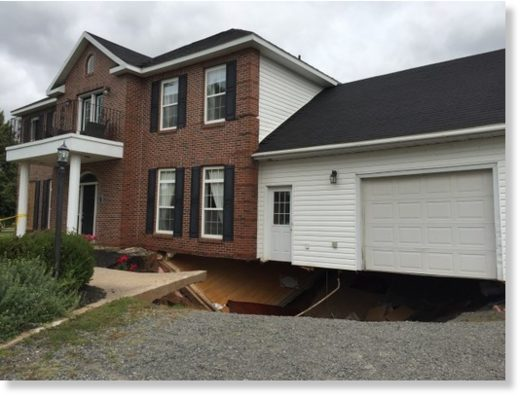 The bottom of this house in Falmouth fell victim to a sinkhole on Sunday