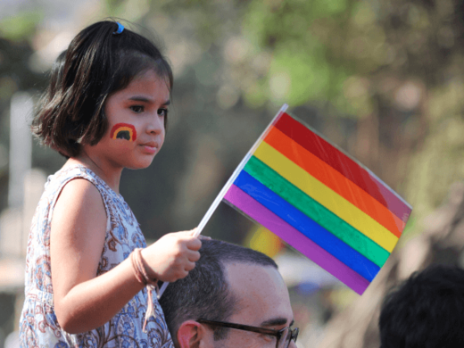 child with pride flag