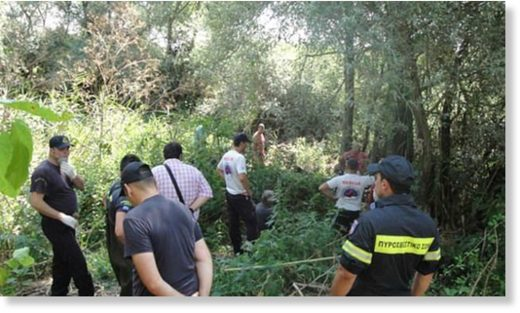 Authorities (pictured during the search) found the 64-year-old tourist dead on Saturday, with marks suggesting she had been savaged by animals in the northern region of Rodopi