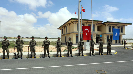 Turkish military officers parade during the opening ceremony of a Turkish military base in Mogadishu