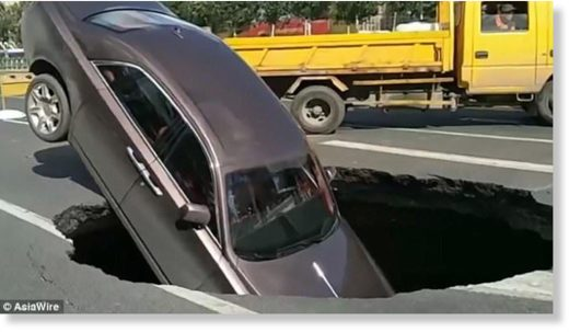 A Rolls-Royce Phantom fell into a massive sinkhole in northern China's Harbin on October 1