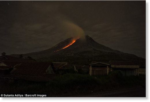 Lava flows from crater of Mount Sinabung during an eruption in Karo, Indonesia, on Sunday