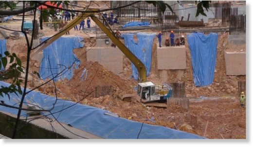 Rescue officers will have to excavate a 35m heap of earth in order to rescue those trapped.