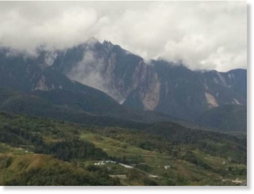 A massive landslide swept down the foothills of Mount Kinabalu this afternoon, triggering panic among the locals here.
