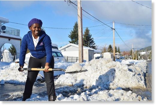Linda Maz shovels out her driveway on Sparks Ave. after the 57cm snowfall on the weekend.