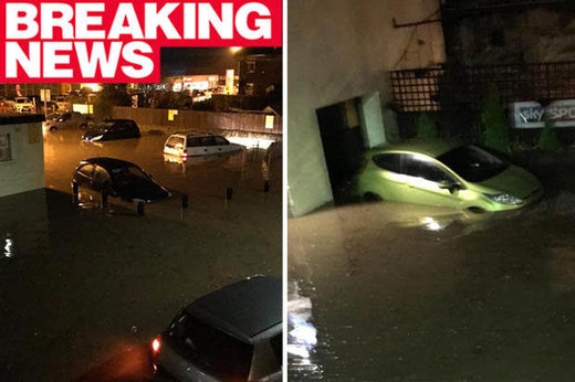 torrential rainfall floods UK