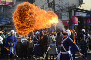 Sikh Nihang (warrior) performs a fire breathing Energy-based alien life