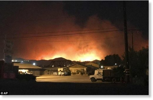 The 10,000-acre wildfire, known as the Thomas Fire, burned dry brush after erupting earlier in the evening in Ventura County (pictured)