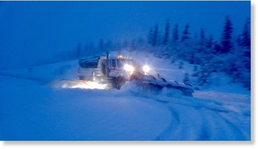 Snowplows clearing the Richardson Highway near Thompson Pass, Alaska.
