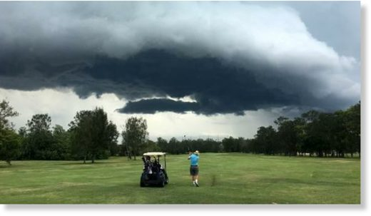 Stormclouds gather over Nudgee Golf Club yesterday.