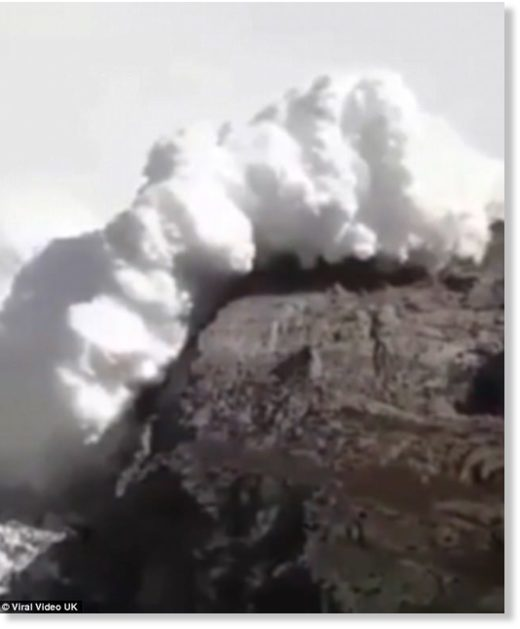 A huge plume of snow is seen tumbling towards the hikers and making its way over the mountains