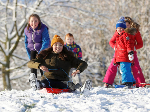 Children play in the snow in Newcastle-under-Lyme, Staffordshire