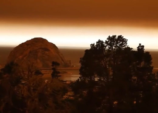 Eery apocolyptic glow seen on the horizon as Californian skies dimmed by smoke from unusual December fires