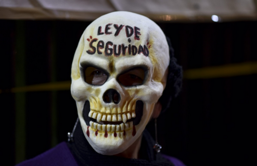 Mexico demonstrator Security Law skull mask