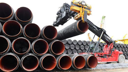 Pipes for the Baltic Sea pipeline being transported for loading onto a ship in the premises of the harbour in Mukran, Germany
