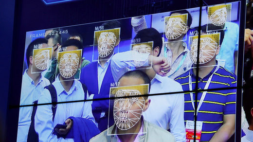 Visitors experience facial recognition technology at Facebook booth