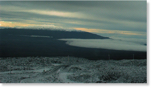 Mauna Kea, as seen from snow covered Mauna Loa