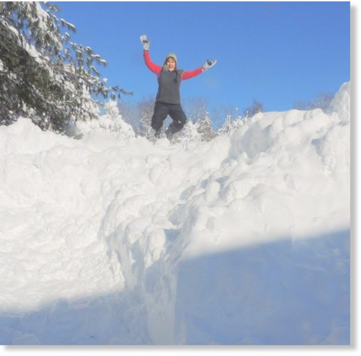 Caroyln Yerdon, the NWS observer in Redfield, climbed atop a 15-foot pile of snow on Wednesday to celebrate Redfield's (unofficial) record for the most snow to fall in Oswego County in 48 hours.