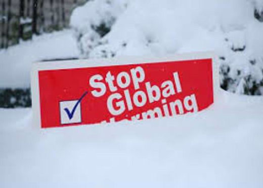 Stop global warming sign under snow