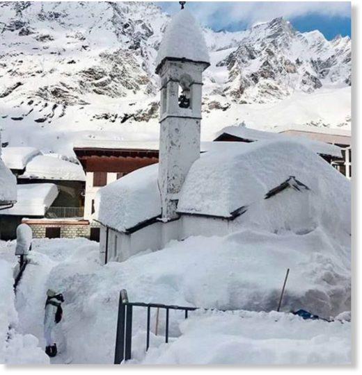 A church covered in snow in Cervinia.