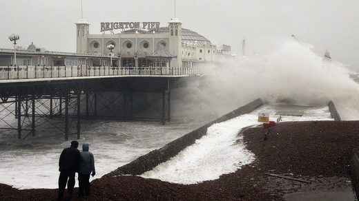 Large waves crash at Brighton Pier