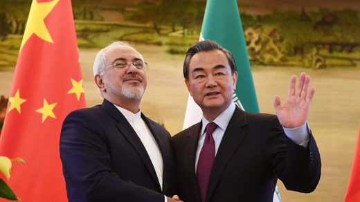 Iranian FM Mohammad Javad Zarif shakes hands with his Chinese counterpart Wang Yi