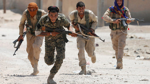 FILE PHOTO Kurdish fighters from the People's Protection Units (YPG)