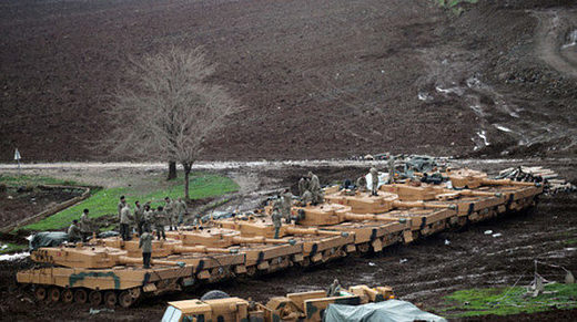 Turkish army tanks are seen near the Turkish-Syrian border in Hatay province, Turkey January 23, 2018