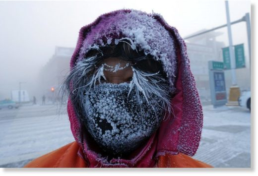 This photo taken on January 24, 2018 shows ice forming on the face of a Chinese sanitation worker on a cold winter day in Hulun Buir, northern China's Inner Mongolia region.