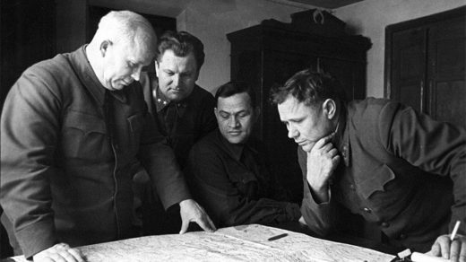 Soviet leaders reviewing a map of Stalingrad