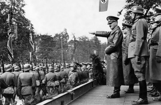 Hitler oversees a victory parade in Warsaw
