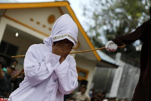 woman whipped sharia indonesia aceh