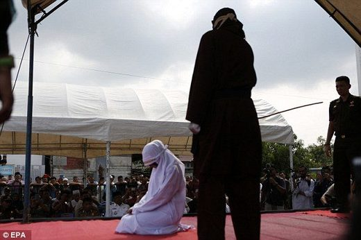 An Acehnese woman was also lashed as part of the public caning on Friday outside a mosque after prayers had finished
