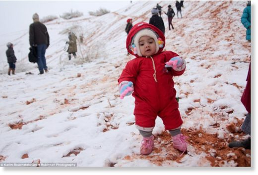 Do you wanna build a snowman? A young resident is making the most of the rare snowfall while playing on the sand dunes