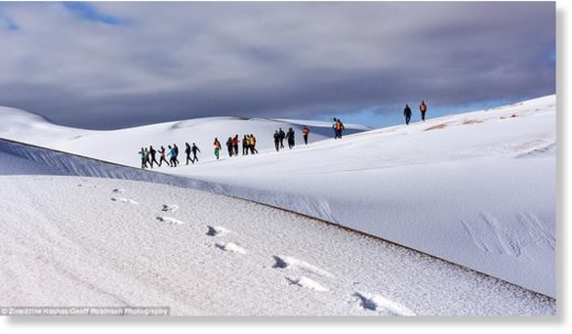 Climb every mountain: The heavy snowfall makes the sand dunes look like snow-covered Alpine mountains