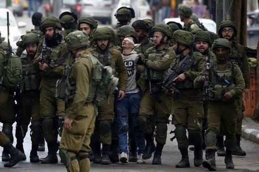 Israeli soldiers Palestinian boy Jerusalem